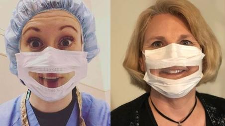 due persone indossano le mascherine trasparenti